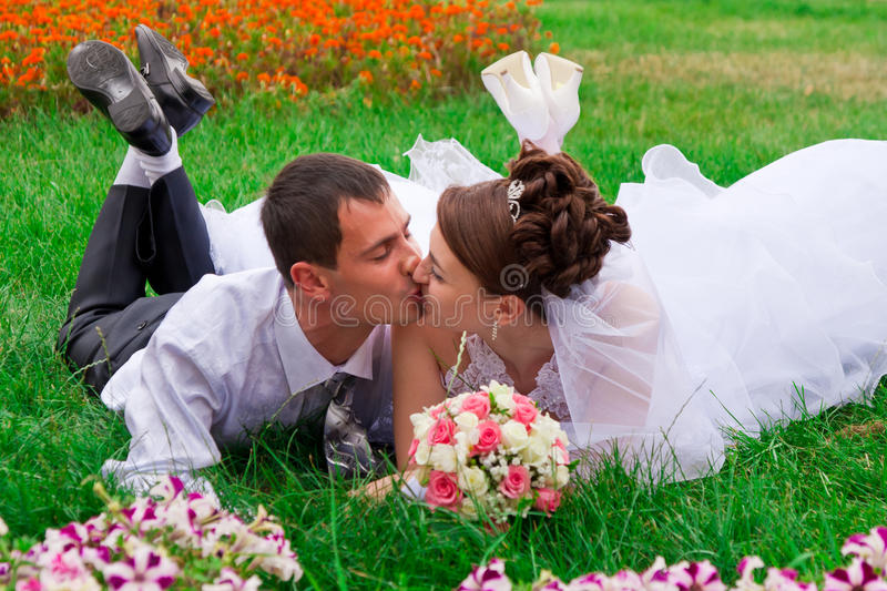 Happy bride and groom kssing stock photography