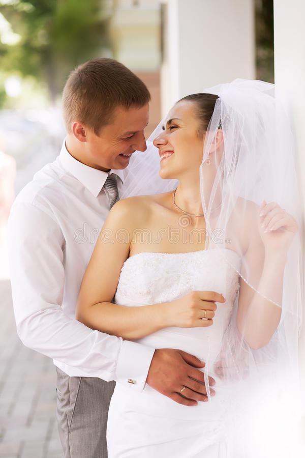 Happy bride and groom laughing stock image