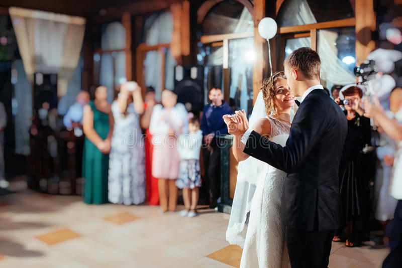 Happy bride and groom a their first dance, wedding stock images