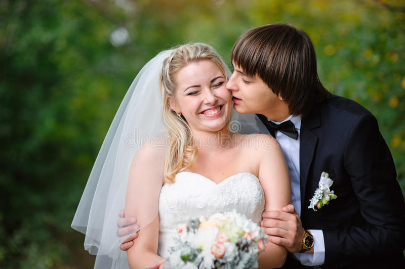 Happy bride and groom on their wedding royalty free stock photos