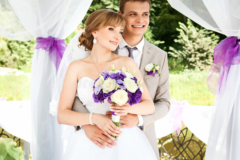 Happy bride and groom on their wedding. stock image