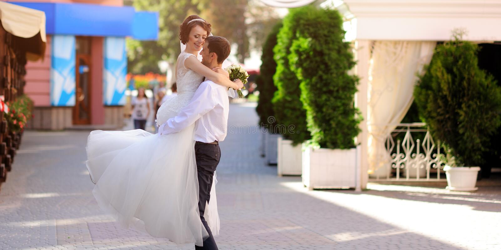 Happy bride and groom on their wedding day royalty free stock image
