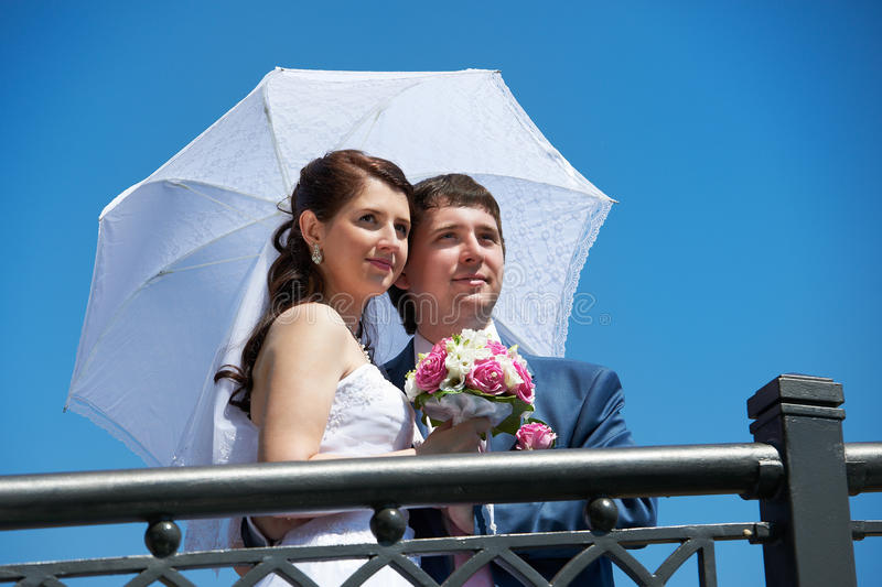 Download Happy Bride And Groom With Umbrella Stock Image - Image: 24255099