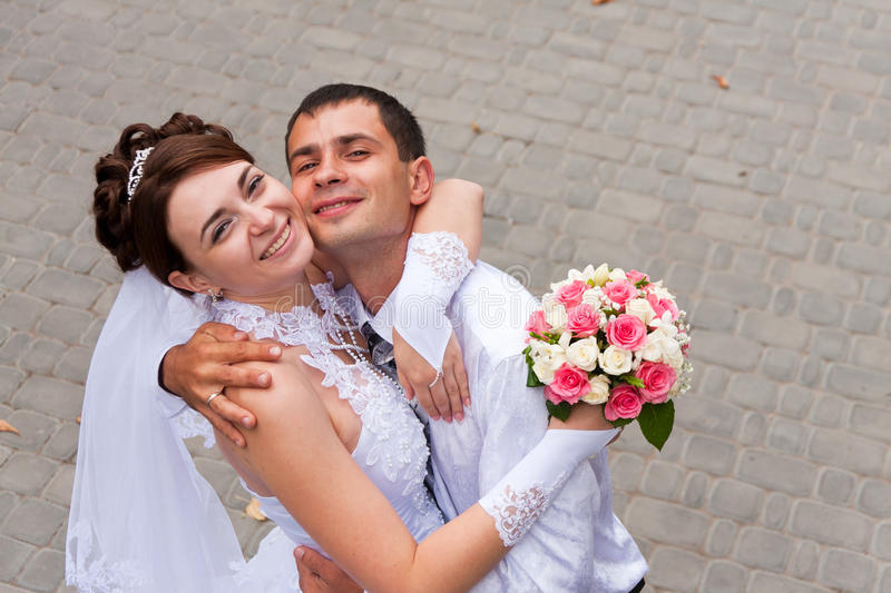 Happy bride and groom at the wedding walk stock photography