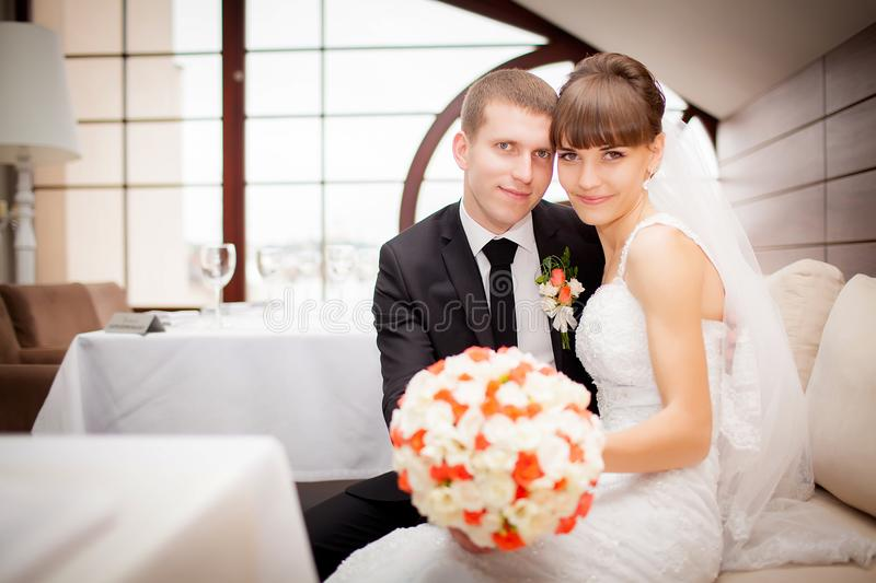 Happy bride and groom on the wedding walk in the modern hotel ha stock images