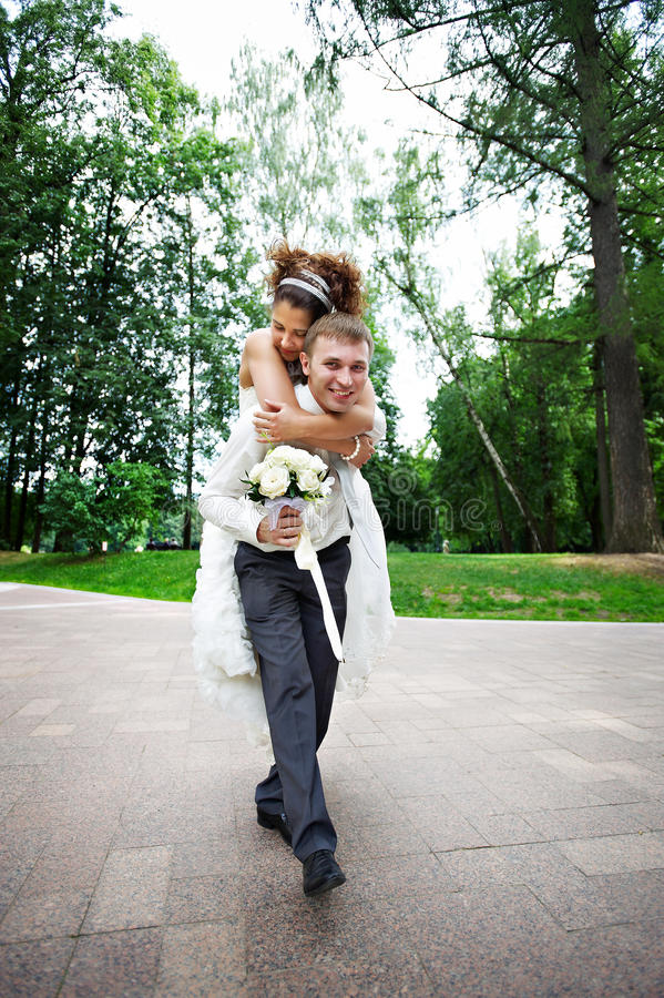Download Happy Bride And Groom At Wedding Walk In The Park Stock Photo - Image: 12693728
