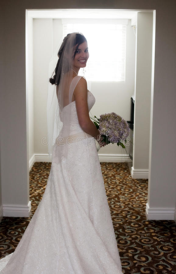Happy bride in hallway stock photos