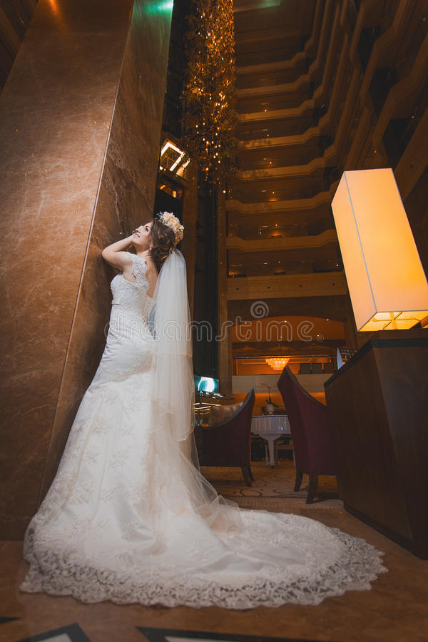 Happy bride in the modern hotel hall