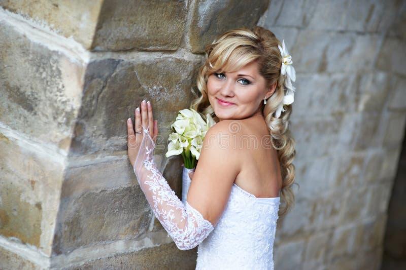 Download Happy Bride Near Stone Wall Stock Photo - Image: 26583814