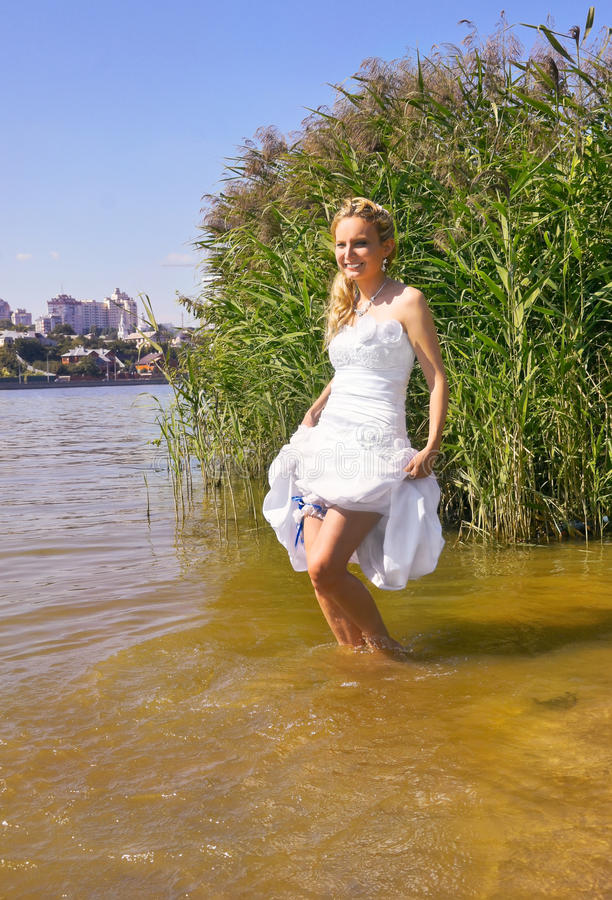 Happy bride in river royalty free stock photography