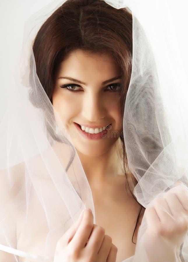Happy bride with veil stock photos
