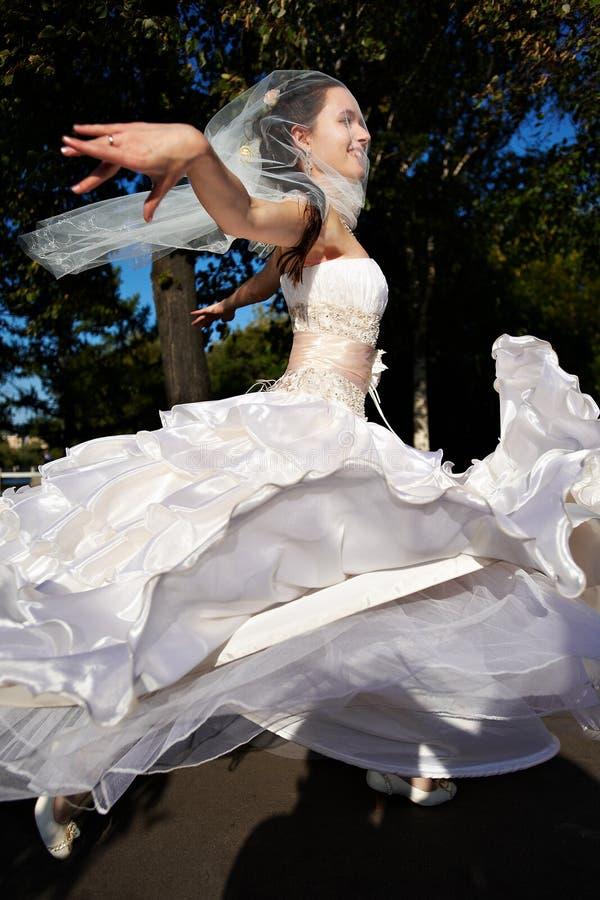 Happy bride wedding dancing stock images