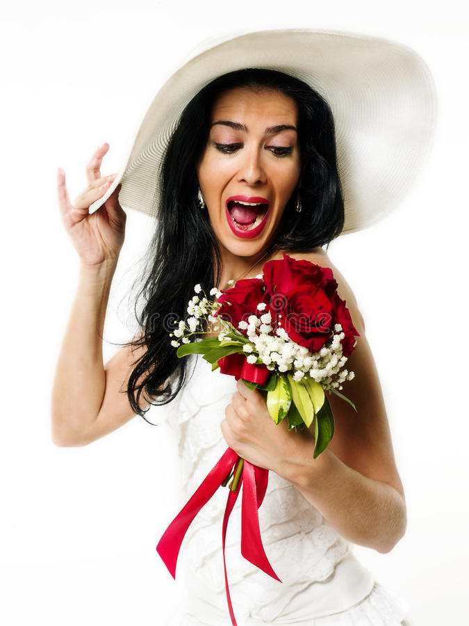 Happy bride with white hat. And bouquet of red roses royalty free stock photography