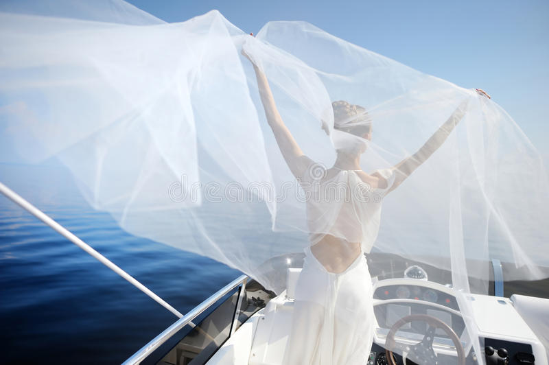 Happy bride on a yacht stock images