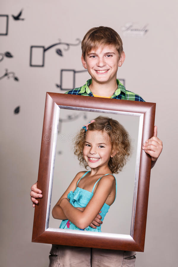 Happy Brother Holding Portrait With His Sister Stock Image - Image ...