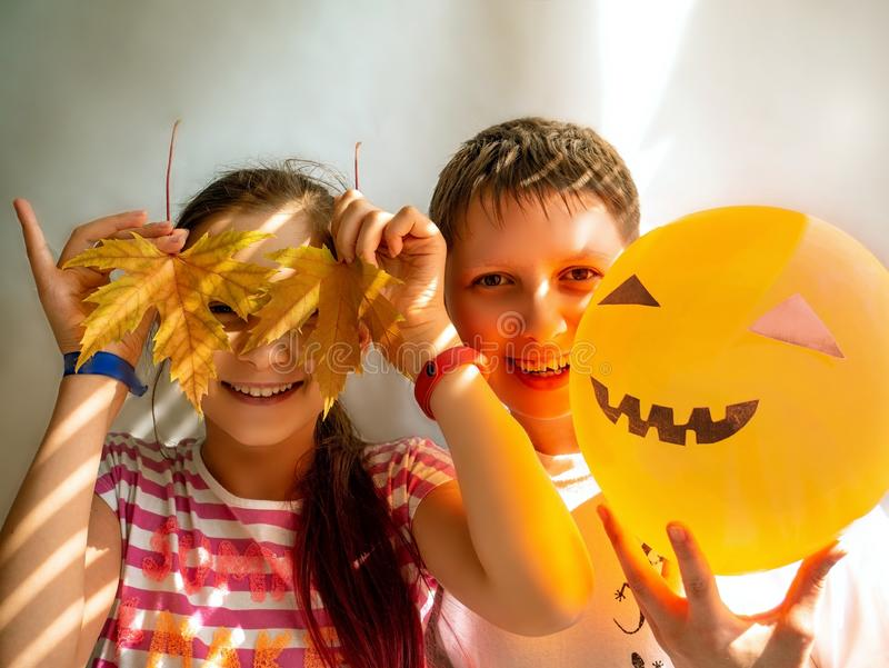 Happy brother and sister on Halloween party. Happy brother and sister on Halloween party on white background stock photography