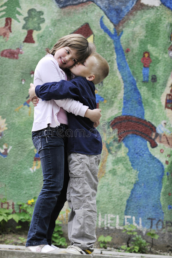 Happy brother and sister outdoor in park royalty free stock photography