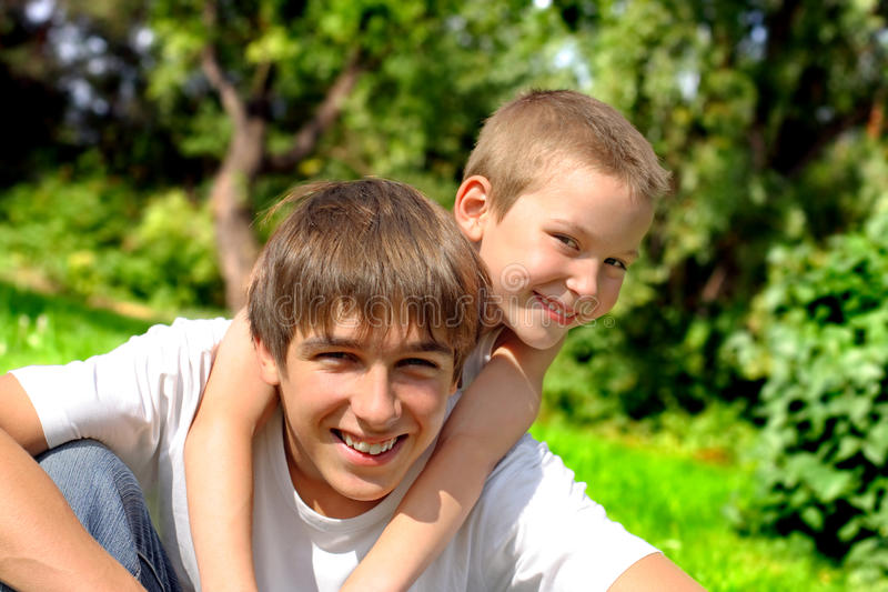 Happy brothers. In the summer park royalty free stock image