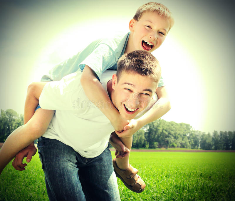 Happy Brothers Outdoor. Vintage photo of Happy Brothers playing in the summer field royalty free stock photography