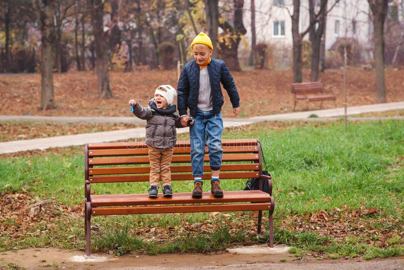 Happy brothers playing in autumn park. Friendship of brothers. Autumn holidays. Family, childhood and child friendship. Kid autumn. Style royalty free stock photos
