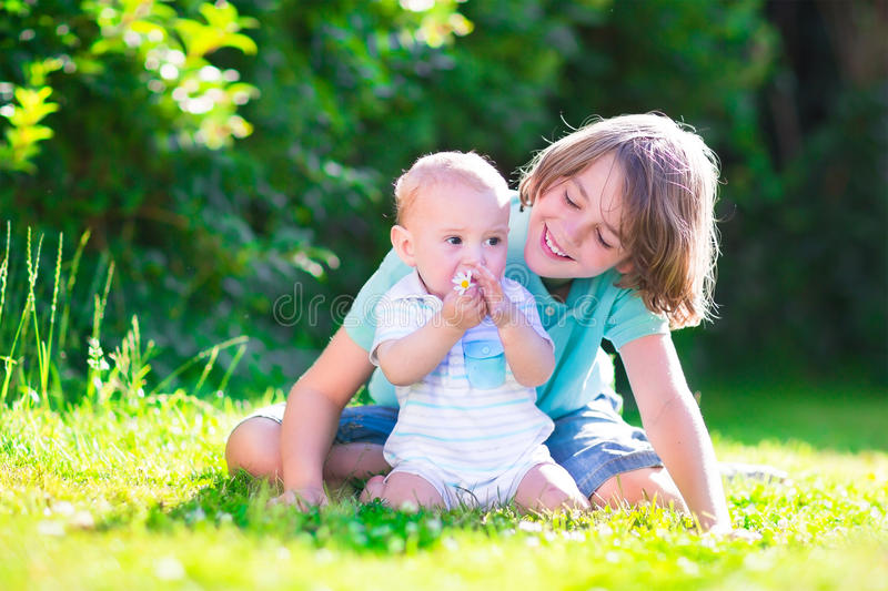 Happy brothers playing in the garden stock photography