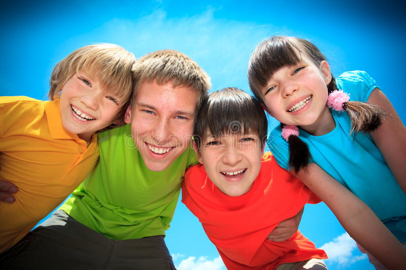 Happy brothers and sister royalty free stock images