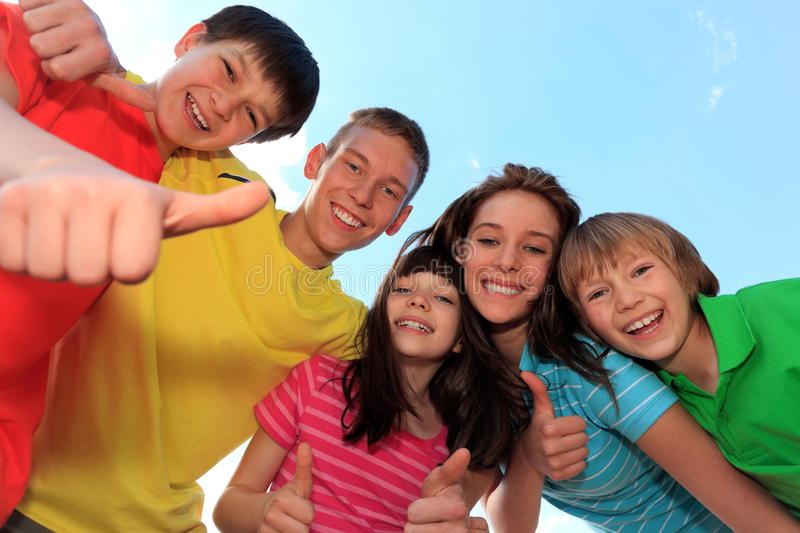 Happy brothers and sisters stock photo