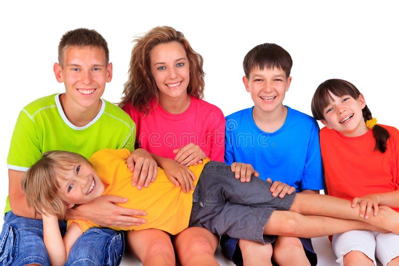 Happy brothers and sisters. Group of five happy young brothers and sisters in colorful clothes, white background royalty free stock photos