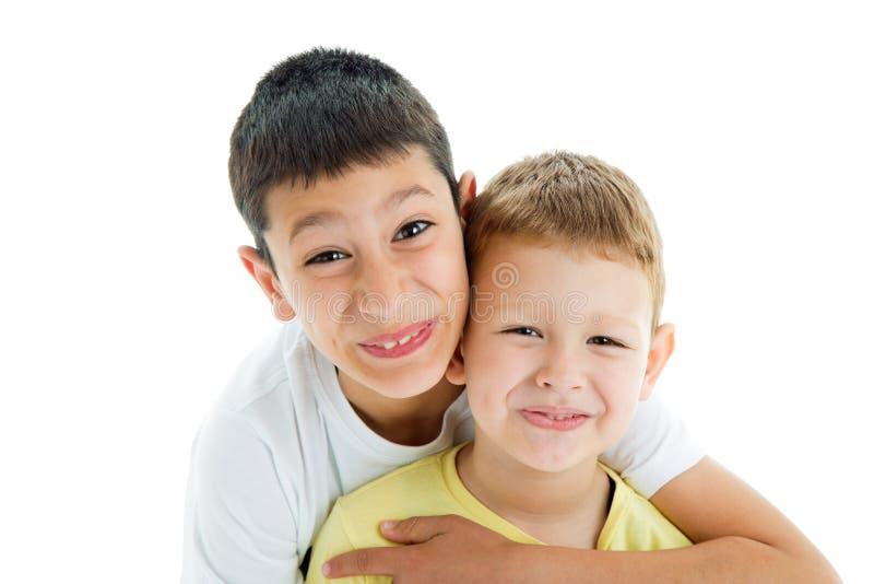 Happy brothers on white stock photos