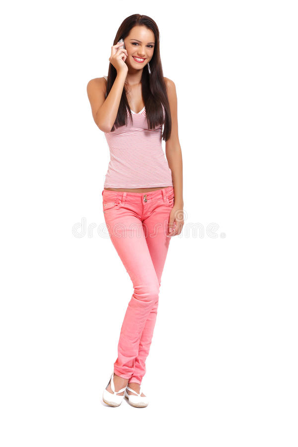 Happy brunette teenager with phone royalty free stock photos