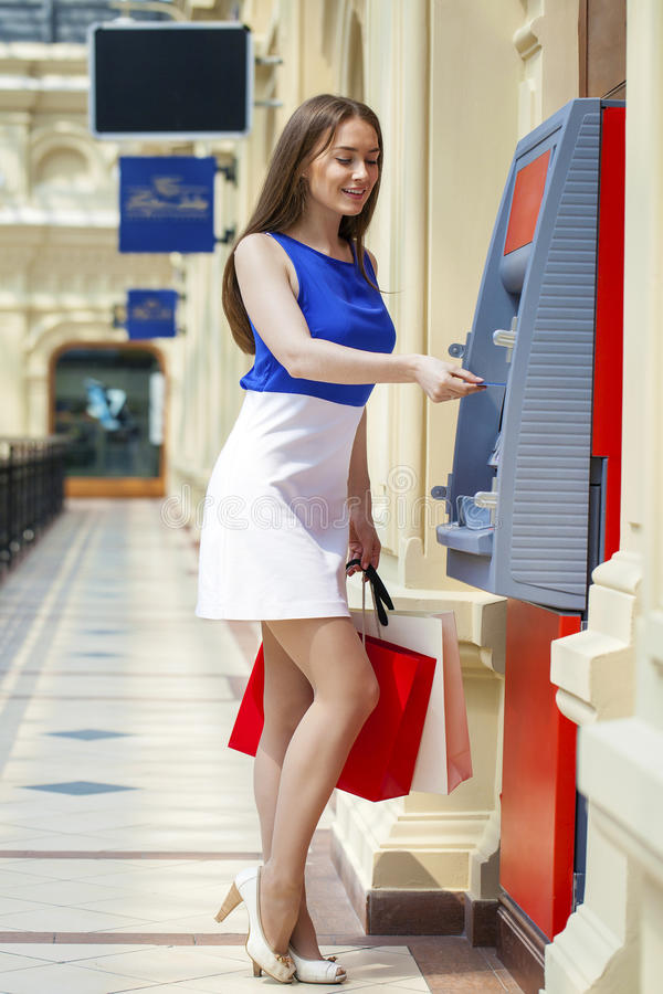 Free Happy Brunette Woman Withdrawing Money From Credit Card At ATM Royalty Free Stock Photo - 75329605