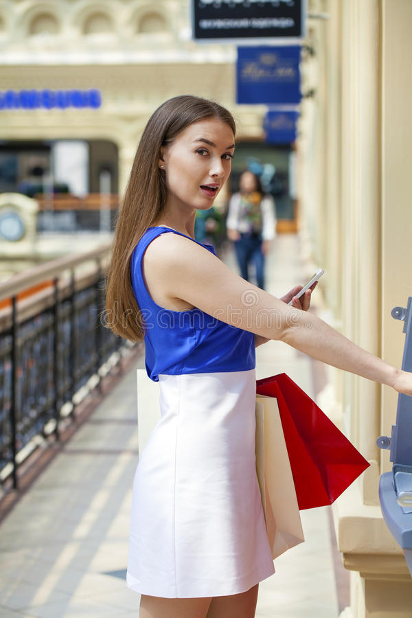 Free Happy Brunette Woman Withdrawing Money From Credit Card At ATM Stock Photos - 75329753
