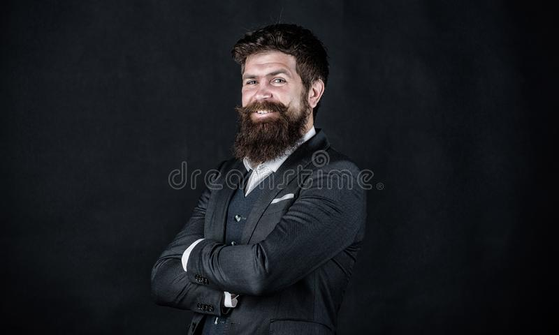 Happy brutal caucasian hipster with moustache. Male formal fashion. Stylish event manager. Businessman in suit. happy royalty free stock images