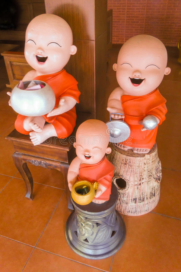 Happy Buddhist novice earthenware. royalty free stock photography
