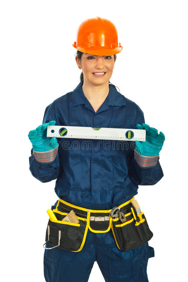 Download Happy Builder Woman Holding Bubble Level Stock Photo - Image: 18949122