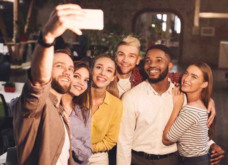 Happy business colleagues taking selfie, having break stock photos