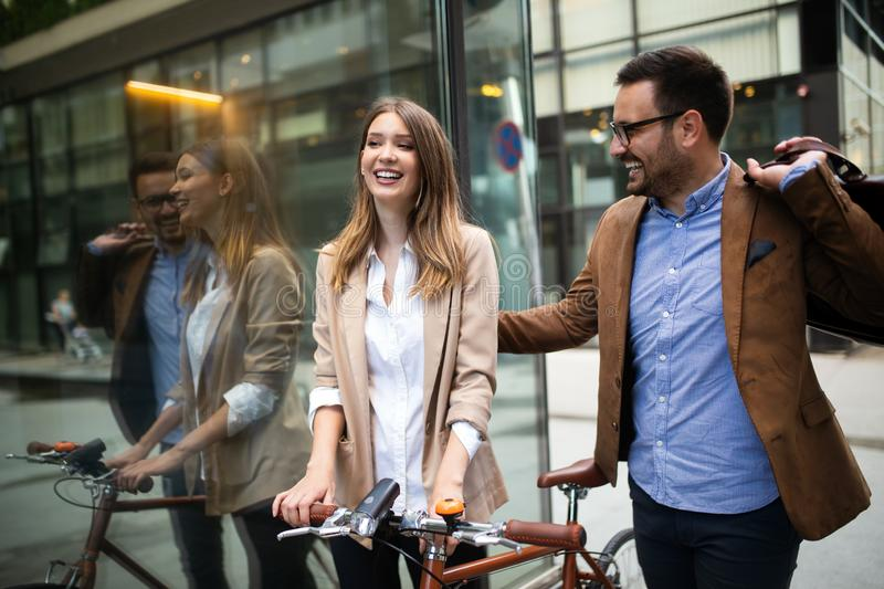 Happy business colleagues talking and walking in the city outdoor royalty free stock photo