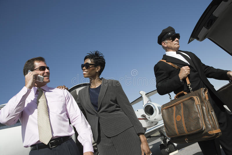 Happy Business Couple At Airfield stock photography