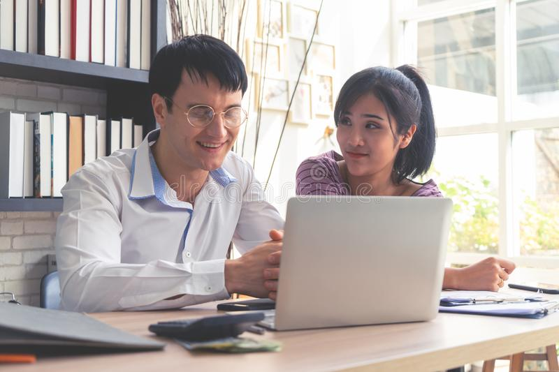 Happy Business Couple working together at home stock photos