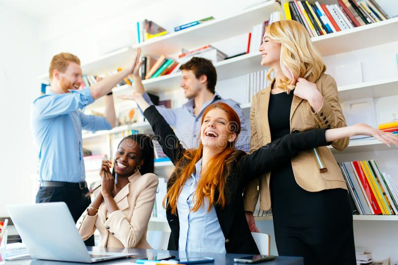 Happy business coworkers celebrating royalty free stock image