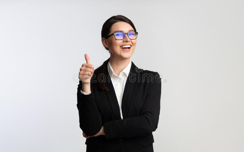 Happy Business Girl Gesturing Thumbs-Up On White Background royalty free stock image