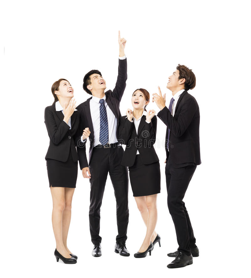 Happy business group pointing and looking up royalty free stock photos