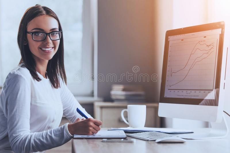 Happy Business Lady Using Computer in Office. Happy Business Lady Using Computer and Smiling while Working in Office. Accountant Manager. Office Administrator stock image