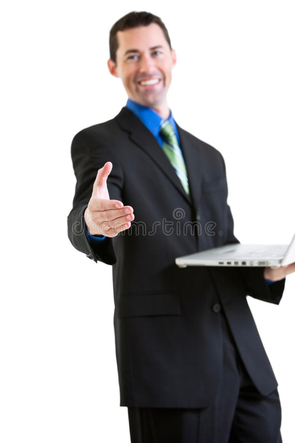 Happy business male on laptop gesturing handshake