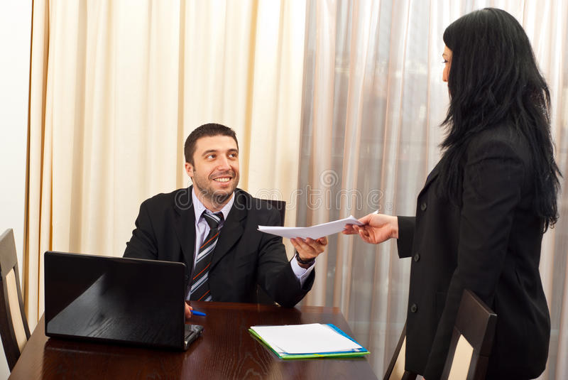 Happy business man give papers to secretary royalty free stock image