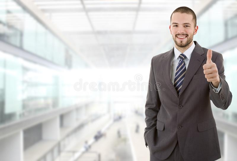 Business man. Happy business man going thumb up, at the office stock image