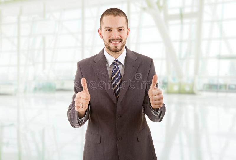 Business man. Happy business man going thumbs up, at the office royalty free stock photos