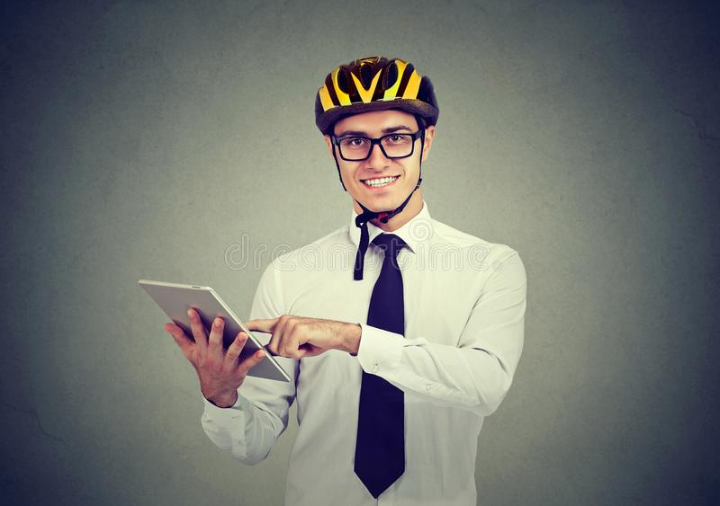 Happy business man in helmet using tablet computer royalty free stock photo