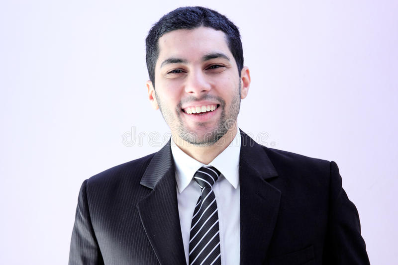Happy business man. Image of arab business man wearing black suit and feeling happy with his success royalty free stock photo