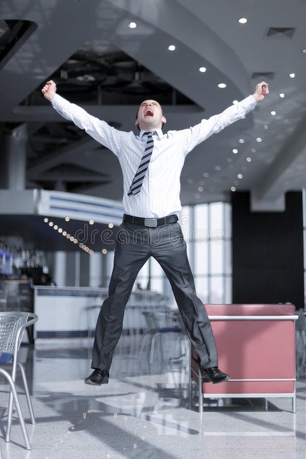 Happy business man jumping royalty free stock photo
